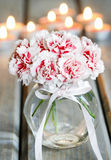 Bouquet of carnation flowers in glass vase Stock Photography