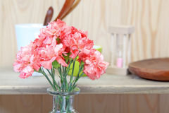 Bouquet of carnation in a glass vase Royalty Free Stock Images