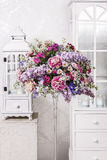 Bouquet of carnations, lilacs and chrysanthemums, wooden lantern Royalty Free Stock Photography