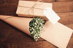 Bouquet of chamomiles. Gift in package with bouquet of chamomiles wrapped in paper Stock Photography