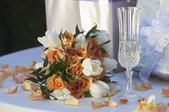 Bouquet With Champagne Flute and Gifts Royalty Free Stock Photos
