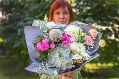 Bouquet of close-up. The girl is holding a bouquet of fresh flow royalty free stock photos