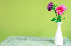 Bouquet of colorful chrysanthemums in a white vase on a vintage Royalty Free Stock Images
