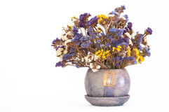 Bouquet of colorful dried sea lavender (limonium). In matching purple jug on isolating background(horizontal image Royalty Free Stock Images