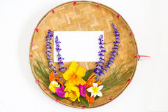 Bouquet of colorful flowers on threshing basket Royalty Free Stock Photo