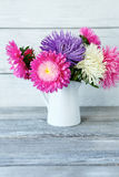 Bouquet of colorful flowers in a white vase Stock Photography