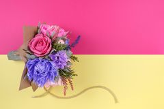 A bouquet of colorful paper flowers on magenta and yellow backgrounds as a backdrop for a postcard, invitation letter and etc.  royalty free stock photos