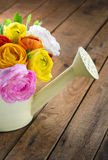 Bouquet of colorful ranunculus on wooden table Royalty Free Stock Photos