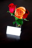 Bouquet of colorful roses in a vase and card Royalty Free Stock Photo