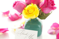 Bouquet of colorful roses in vase,petals and card Royalty Free Stock Images