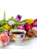 Bouquet of colorful tulips and  tea cup full of tea isolated on Stock Images