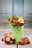 Bouquet of colorful wild flowers in green dotted can Royalty Free Stock Photos