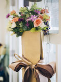 Bouquet of colourful Flowers in brown paper wrap. Home decoration stock photography