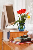 Bouquet and the computer. Stock Photos