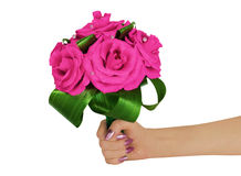 The bouquet consisting of artificial flowers  in a female hand Royalty Free Stock Photo