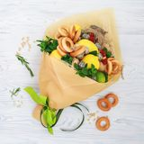 Bouquet consisting of honey, a bunch of bagels, mint leaves, lemons, lime, ginger and red currant on the white stock photos