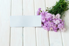 Bouquet of cornflowers on a white wooden background Royalty Free Stock Photos