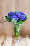 Bouquet of cornflowers in wooden hut Stock Photography