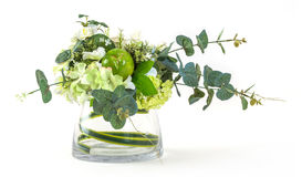 Bouquet of cosmos and eucalyptus in glass vase Royalty Free Stock Photo