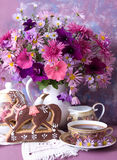 Bouquet and cup royalty free stock photography