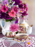 bouquet and cup Royalty Free Stock Photo