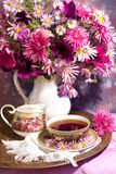 Bouquet a cup of coffee Royalty Free Stock Photography