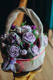 Bouquet of cupcake and marshmallows in a rattan basket. stock photo