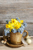Bouquet of daffodils and blue muscari Grape hyacinth Royalty Free Stock Photo