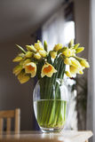 Bouquet of daffodils on weathered wooden table Stock Photos