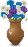 Bouquet of daisies and cornflowers in clay pot Stock Photo