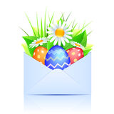 Bouquet of daisies and easter eggs in an open enve Stock Photography