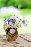 Bouquet of daisies on the table in the garden Stock Image