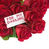 Bouquet de fleur des roses rouges et carte de voeux d'isolement Photo stock
