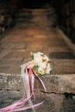 Bouquet de mariage sur un fond en pierre Images stock