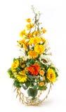 Bouquet de tournesol et de Vanda dans le vase en verre Image stock