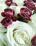 Bouquet of decorative red roses in glass vase Royalty Free Stock Photo