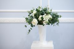 Bouquet of delicate flowers in a white vase royalty free stock photos