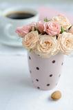 Bouquet of delicate pink roses. In a cup on the table Royalty Free Stock Images