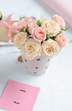 Bouquet of delicate pink roses. In a cup on the table Royalty Free Stock Photography