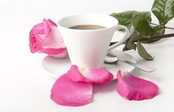 Bouquet of delicate pink roses in a cup on the tab Royalty Free Stock Photo