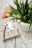 Bouquet of delicate pink tulips on a wooden background and vintage notebook for records Royalty Free Stock Image