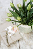 Bouquet of delicate pink tulips on a wooden background and vintage notebook for records Stock Photography
