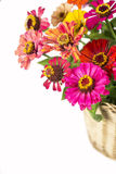 Bouquet from different brights in a basket Stock Image