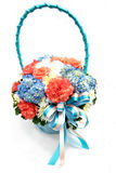 Bouquet with different kind of flowers in basket isolated on whi Stock Photo