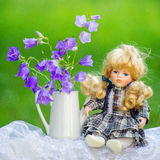 Bouquet and doll Royalty Free Stock Image