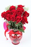 Bouquet of dozen red roses Stock Photo