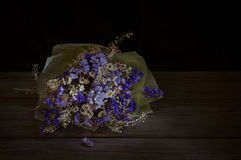 Bouquet of dried flower on wooden background. Royalty Free Stock Images