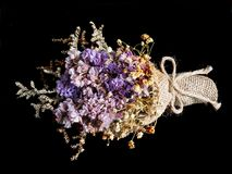 Bouquet of dried flowers. On black background Royalty Free Stock Photos