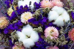 Bouquet of dried flowers with cotton and lavender floral background. Bouquet of dried flowers with cotton and lavender stock image