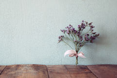 Bouquet of dried flowers rope against wooden background Royalty Free Stock Photo